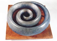 Spiral Levitation - Mold melted glass on metal base. ..click to see full size